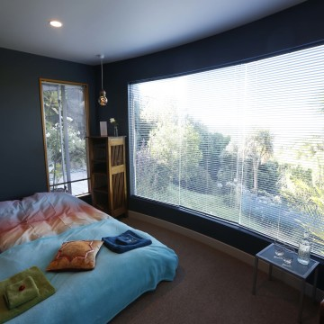 The small cosy Guest Room with views into the garden